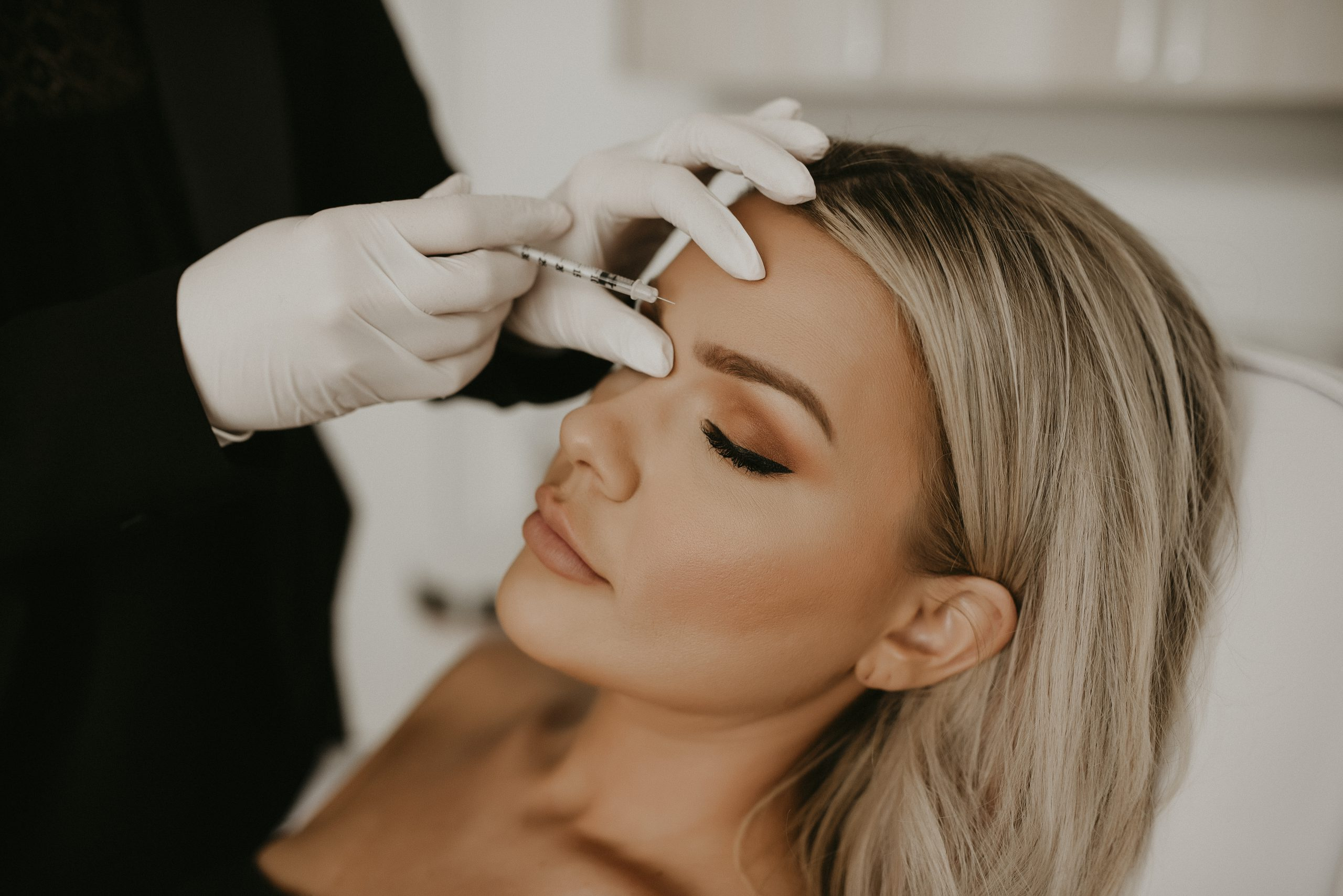jennifer injecting botox into a young woman in Nashville